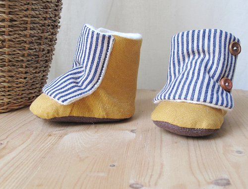 yellow boots with blue stripes and buttons