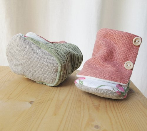 organic baby boots in pink and green